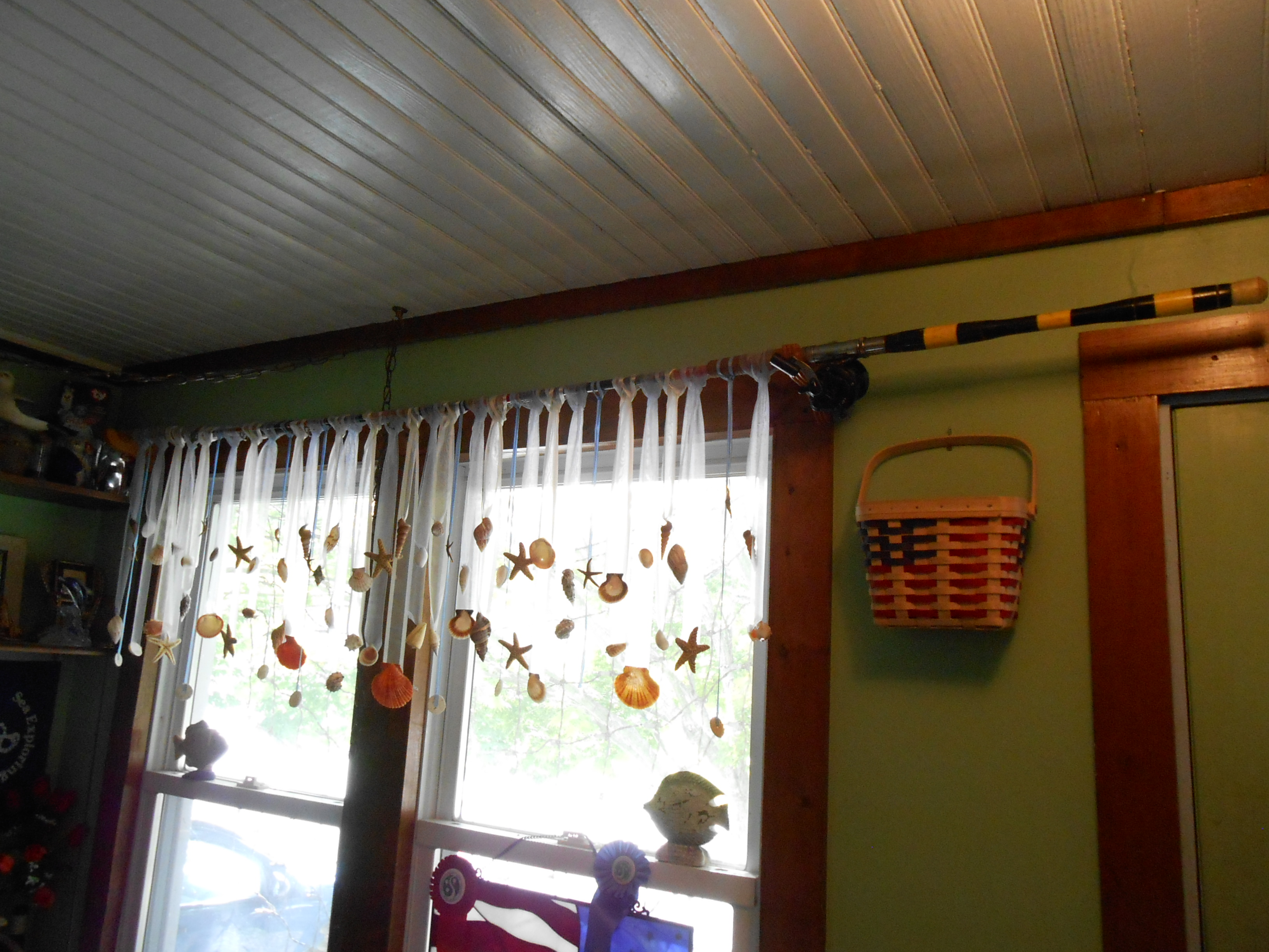 re purposed fishing poles as curtain